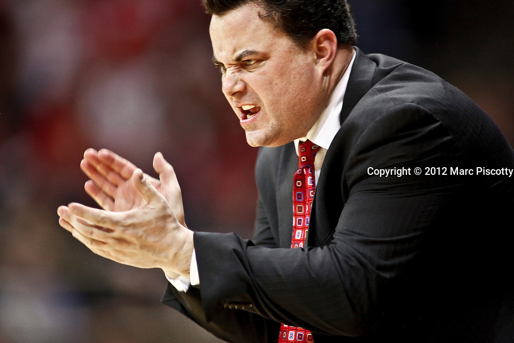 SHOT 1/21/12 6:58:12 PM - Arizona head basketball coach Sean Miller coaches against Colorado during their PAC 12 regular season men's basketball game at the Coors Events Center in Boulder, Co. Colorado won the game 64-63..(Photo by Marc Piscotty / © 2012)