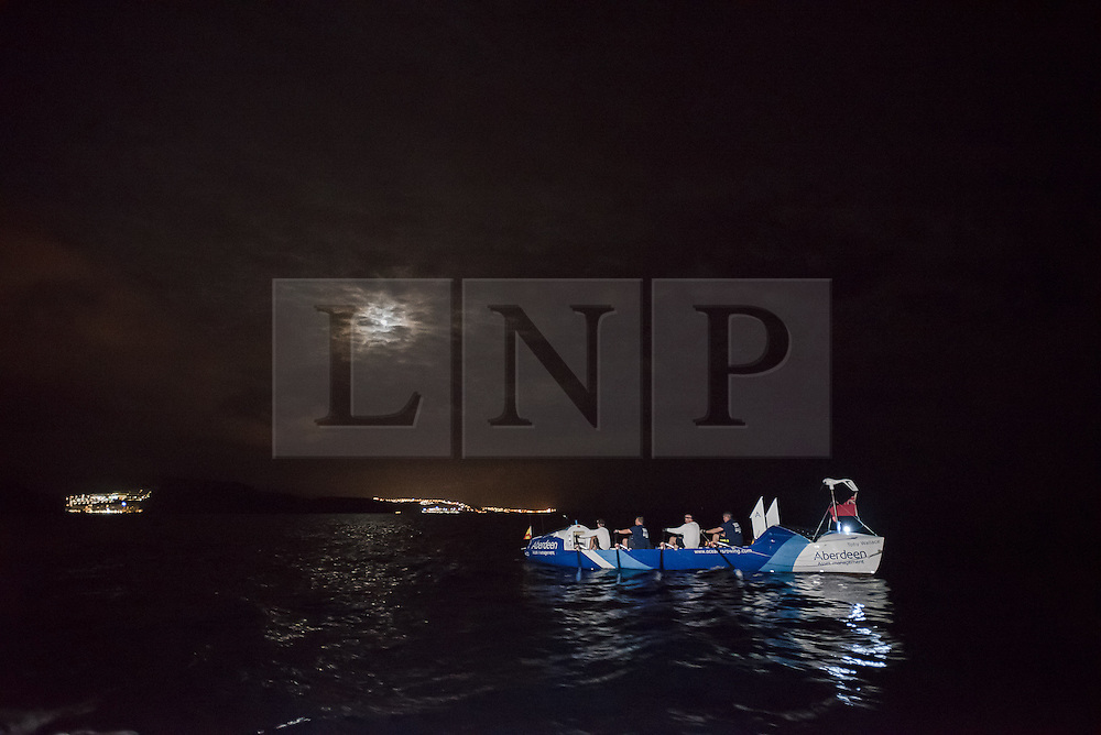 **VIDEO Available here: http://tinyurl.com/hl8y6t3 ** © London News Pictures. File pic 29/01/2016 Puerto de Mogan, Gran Canaria. The crew of The Toby Wallace set off to try and break the record for the fastest crossing by rowing boat of the Atlantic Ocean. MIKE JOHNSON (pictured far left sat in boat)  is currently missing at sea after their boat was rocked by a large wave causing several crew to be thrown over-board. Coastguards have now called off a search for a 21-year-old Zimbabwean rower Mike Johnson. Photo credit: credit: Ian Homer/LNP