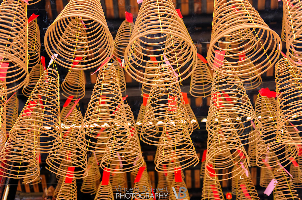 Incense Coils hanging from the ceiling of a Buddhist temple in Ho Chi Minh City, Vietnam.