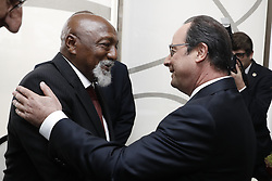 French President Francois Hollande (R) shakes hands with Brazilian former football player Paulo Lima Cesar Caju during his visit to Brazil to attend the Opening ceremony of the 2016 Olympic Games, in Rio de Janeiro, Brazil on August 4, 2016. Hollande flew in to Rio de Janeiro aboard a jet bearing the logo of the Paris 2024 Olympic bid for a two-day lobbying visit. Photo by Jack Guez/Pool/ABACAPRESS.COM