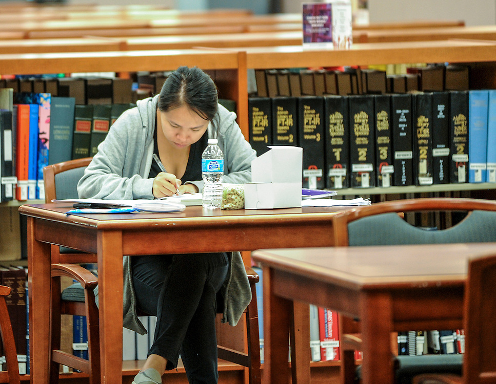 A Kent State student studies in in the library during the summer semester.