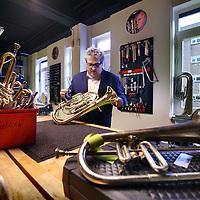 Nederland, Amsterdam , 24 november 2014.<br /> Marco de Souza, directeur/oprichter van Stichting Leerorkest in 1 van de instrumenten depots in de Batjanstraat in Amsterdam Oost.<br /> Foto:Jean-Pierre Jans