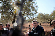 Soldiers of the Free Syrian Army. On 22. February the syrian army attacked the village of Kureen, Province of Idlib, Syria. Kureen was among the first villages in the northwest of Syria controlled by the opposition. Some villagers and members of the defence units escaped to surrounding olive orchards, when the attack begun in the early morning. A majority of the inhabitants didn´t manage to escape. The heavy shelling lasts 7 houres. Soldiers searched all houses, burnt some of them down, loote shops, stole cars and furniture. About 60 motorcycles were burnt down. Tanks demolished several houses. 6 men were executed. One woman died as a result of an heart attack.