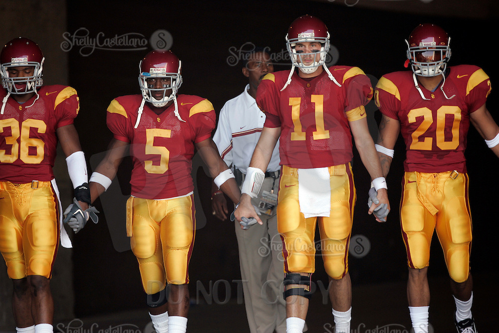 29 October 2005: USC Trojans (L-R) #36 Josh Pinkard, #5 Reggie Bush, #11 Matt Leinart, #20 Darnell Bing holds hands walking out of the tunnel before a 55-13 win over the Washington State Cougars at the Los Angeles Memorial Coliseum, CA. Pac-10 College Football tradition.