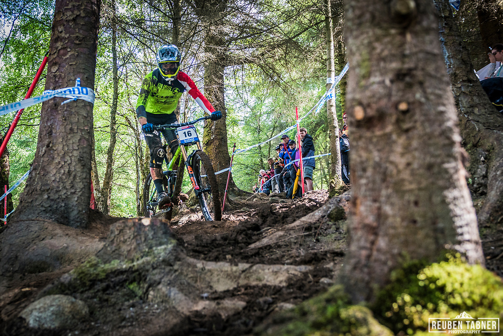 Greg Williamson cuts through the trees during his Qualifying Run at the UCI Mountain Bike World Cup in Fort William.