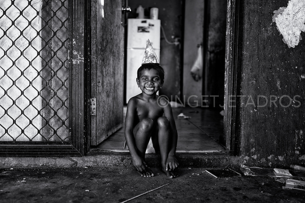 "Marjorie was happily smiling while sitting on the doorstep of her family home in Kennedy Hill. ""I am 5 now !"" and gave me the biggest smile when I came over to bring her a birthday present. Broome, Western Australia. ©Ingetje Tadros/Diimex"