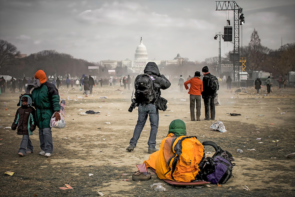Attendees of Barack Obama's 2009 Inauguration, afterwards, bracing high winds and frigid temperature on The Mall, in Washington, D.C.. Copyright 2009 Reid McNally.