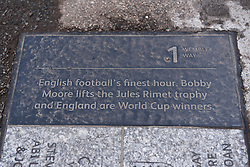 © Licensed to London News Pictures. 26/04/2018. LONDON, UK.  One of many commemorative plaques outside Wembley Stadium.  It is reported that the Football Association (FA) has received a bid of GBP800m from Shahid Khan, owner of Fulham FC and the Jacksonville Jaguars NFL franchise, to purchase the stadium.  If the bid is successful, the FA will retain its organisational base at the stadium, but will open the way for the creation of the first NFL franchise located out of the United States.  Photo credit: Stephen Chung/LNP