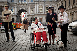 © Licensed to London News Pictures. 10/11/2017. London, UK. The only female holder of the Burma Star, Constance Halford-Thompson (C), 90yrs, who signed up underage before the fall of Singapore., joins members of the Chelsea Arts Club assemble to drill at The Royal Academy of Arts honoring their predecessors who in 1914 formed a corps called the United Arts Rifles, or the 'Unshrinkables' owing to their unorthodox dress before issue of uniform (made up largely of woollen cricket whites, advertised as 'unshrinkable'). They will parade once more in 2018, marking the end of the Great War. Photo credit: Guilhem Baker/LNP<br /> <br /> Royal Academy of Arts Unshrinkables Remembrance Parade.  Photo credit: PHOTOGRAPHERS NAME/LNP