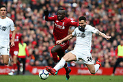 Burnley defender Phillip Bardsley (26) stretches to get the tackle on Liverpool forward Sadio Mane (10) during the Premier League match between Liverpool and Burnley at Anfield, Liverpool, England on 10 March 2019.