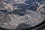 view from passenger airplane on departure from Narita Tokyo Japan