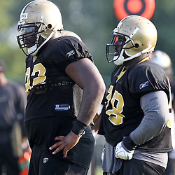 August 6, 2011; Metairie, LA, USA; New Orleans Saints defensive tackles Shaun Rogers (92) and Sedrick Ellis (98) during training camp practice at the New Orleans Saints practice facility. Mandatory Credit: Derick E. Hingle