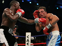 WBC Junior Welterweight Champion Arturo Gatti (r) and challenger Floyd Mayweather trade punches during their 12 round bout at Boardwalk Hall in Atlantic City, NJ.  Floyd Mayweather won the fight via 7th round stoppage.