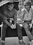 Journalist  and good friend Peter Windsor poses a question to Lotus F1 driver Nigel Mansell before the start of the 1984 Detroit Grand Prix. <br /> <br /> Mansell had experienced tremendous pressure and resistance within Lotus from team manager Peter Warr  following the death of Lotus founder Colin Chapman in 1982. There were rumors that Warr had no intention of honoring the last year of Mansell's contract agree to before Chapman's death. And, with rising star Ayrton Senna rumored to be moving to the team, Mansell was desperate for outstanding results. Unfortunately, the Lotus 95T continued to be unreliable...Mansell retired from five of the last seven Grands Prix when the car and or engine failed, and the 1984 Detroit Grand Prix would be failure number six.<br /> <br /> It would be Windsor that came to his aid. In 1985 Windsor accepted a position with Williams F1 to managing their sponsorship and public affairs, and his timely words to Frank Williams seemed to make a difference. Mansell joined Williams that same year and began to rebuild his career. He would win his first Grand Prix, the European Grand Prix at Brands Hatch, England, and defeat Ayrton Senna's Lotus in the process and match it with the a victory in the South African grand Prix 13 days later. <br /> <br /> Mansel would go on to finish 2nd in the World Driver's Championship three times with Williams and Ferrari, finally winning the World Championship in a triumphant return to Williams in 1992.<br /> <br /> In all, 31 victories; the most Grand Prix wins by a British Formula One driver of all time.