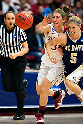 March 19, 2011; Stanford, CA, USA; Stanford Cardinal guard Toni Kokenis (31) and UC Davis Aggies guard Hannah Stephens (5) fight for a loose ball during the first half of the first round of the 2011 NCAA women's basketball tournament at Maples Pavilion.