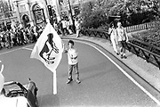 Lone Protester waving flag at the 1st Criminal Justice March.Marble Arch, London, UK, 1st of May 1994.
