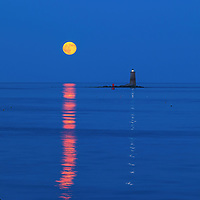Maine, the way life should be showing the Whaleback Lighthouse with buck full moon in southern Maine near the New Hampshire border. This historic New England lighthouse is located near Portsmouth, NH and is also known as Whaleback Light or Whaleback Ledge Lighthouse. A rising full moon always attracts a lot of nature lovers and photographers alike and there was no difference last night. Originally, I was inspired by the tall and old lighthouse structure out in the ocean that tells the story of bracing Mother Nature for a century and more. After setting up tripod and camera I patiently waited for the moonrise and when it finally arrived I photographed away to ensure I captured my vision of this unforgettable natural phenomenal.   <br />