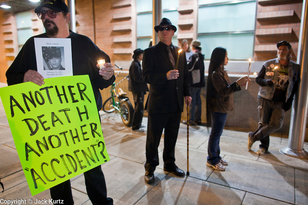 "04 JANUARY 2012 - PHOENIX, AZ:    TOM DYSON, left, CRAIG SLOMIN, KEN ALANDT and LOVELY DYSON during a vigil for Marty Atencio in front of the Maricopa County Jail in Phoenix on January 4. Atencio died in a Phoenix hospital on Dec 20, 2011. He was arrested by Phoenix police a few days earlier after he exhibited ""bizarre"" behavior on the street. He was booked into the Maricopa County Jail. During the booking process he was tackled by Maricopa County Detention Officers and repeatedly hit was a Taser stun gun. He was later found unconscious in a holding cell and transferred to a hospital, where he died four days later. An autopsy showed no signs of illegal drugs or intoxication and a video from the jail showed that Atencio was not violent in the jail. His family has hired a lawyer and may sue the Maricopa County Sheriff's Department, which administers the jail.     PHOTO BY JACK KURTZ"