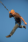 Guy swinging on ropes at the College of Southern Idaho Challenge Rope Course Twin Falls, Idaho.