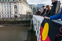 London, UK. 25th January, 2019. Activists drop a banner and an aboriginal flag from Westminster Bridge, in view of the Houses of Parliament, to call for the abolition of Australia Day in advance of rallies in every Australian city on Australia Day tomorrow. The event was organised in solidarity with Aboriginal and Torres Strait Islander people who consider Australia Day, a day celebrating the colonisation of Australia, to be a day of mourning rather than a day of celebration. Aboriginal and Torres Strait Islander people will, instead, stage 'Invasion Day' and 'Survival Day' protests and commemorations across Australia.