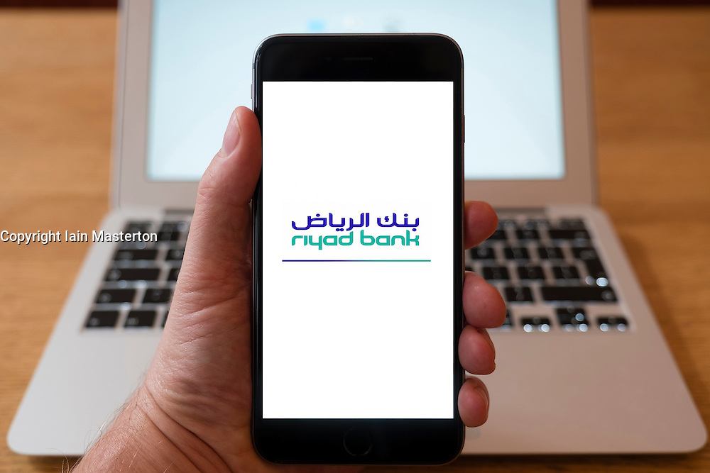 Using iPhone smart phone to display website logo of Riyad Bank from Saudi Arabia