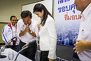 03 MARCH 2013 - BANGKOK, THAILAND: .PONGSAPAT PONGCHAREON, the Pheu Thai candidate for Governor of Bangkok, wais (the formal Thai greeting) YINGLUCK SHINAWATRA, the Thai Prime Minister, after announcing that he lost the Bangkok Governor's election. Pongsapat Pongchareon, running on the Pheu Thai ticket, lost the Bangkok's Governor's race to MR Sukhumbhand Paribatra, the incumbent running on the Democrat ticket. Sukhumbhand won the race after scoring a record number of votes, more than 1.2 million to Pongsapat's 1 million. The results were seen as an upset even though Sukhumbhand was the incumbent because all of the pre-election polls and the exit polls conducted on election day showed Patsapong winning.     PHOTO BY JACK KURTZ