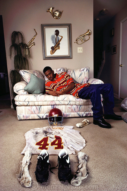"Toy ""Troy"" Trice (15 years old) was hit by lightning during high school football practice in September of 1991. The strike tore a hole in his helmet, burned his jersey and blew his shoes off. He recovered from a two-day coma with burns and memory loss. Trice at home with the equipment he was wearing when hit. MODEL RELEASED (1993)"