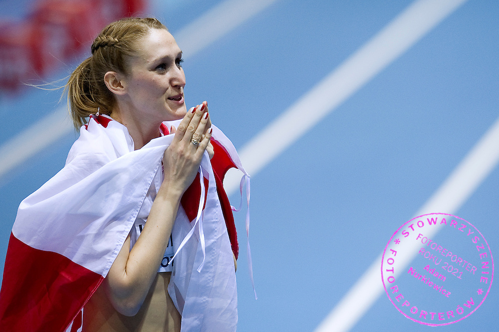 Kamila Licwinko (maiden name: Stepaniuk) of Poland celebrates her  gold medal and World Champion title in women's high jump final during the IAAF Athletics World Indoor Championships 2014 at Ergo Arena Hall in Sopot, Poland.<br /> <br /> Poland, Sopot, March 8, 2014.<br /> <br /> Picture also available in RAW (NEF) or TIFF format on special request.<br /> <br /> For editorial use only. Any commercial or promotional use requires permission.<br /> <br /> Mandatory credit:<br /> Photo by &copy; Adam Nurkiewicz / Mediasport