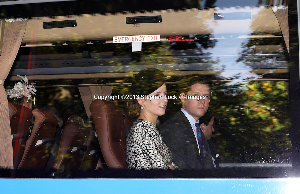 Guests arriving in a mini bus at  Prince George's  christening at St.James's Palace in London, Wednesday, 23rd October 2013. Picture by Stephen Lock / i-Images