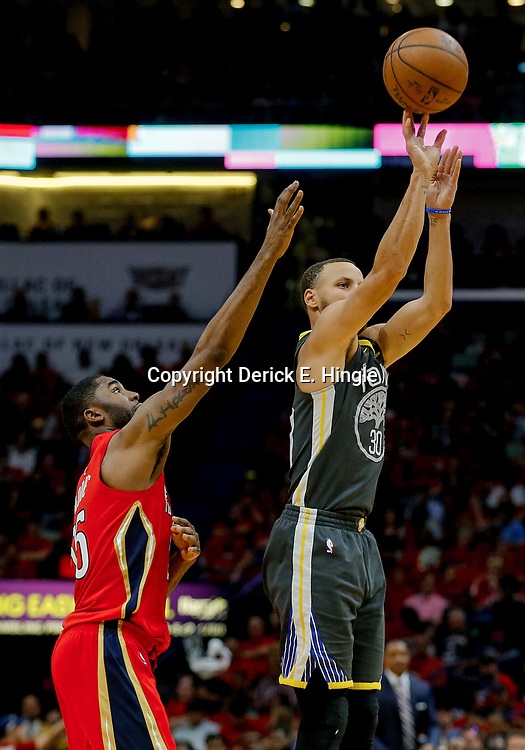 May 6, 2018; New Orleans, LA, USA; Golden State Warriors guard Stephen Curry (30) shoots over New Orleans Pelicans forward E'Twaun Moore (55) during the second quarter in game four of the second round of the 2018 NBA Playoffs at the Smoothie King Center. Mandatory Credit: Derick E. Hingle-USA TODAY Sports