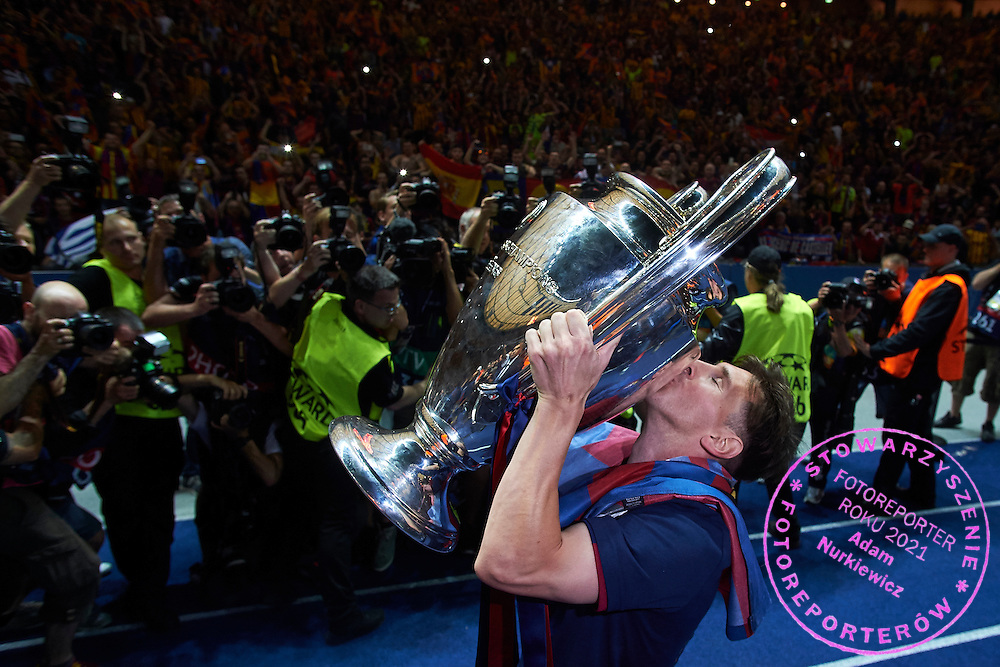 Lionel Messi of FC Barcelona kisses the Champions League Cup after victory during the 2014/15 UEFA Champions League Final between Juventus and FC Barcelona at Olympiastadion on June 6, 2015 in Berlin, Germany.<br /> Germany, Berlin, June 6, 2015<br /> <br /> Picture also available in RAW (NEF) or TIFF format on special request.<br /> <br /> For editorial use only. Any commercial or promotional use requires permission.<br /> <br /> Adam Nurkiewicz declares that he has no rights to the image of people at the photographs of his authorship.<br /> <br /> Mandatory credit:<br /> Photo by &copy; Adam Nurkiewicz / Mediasport