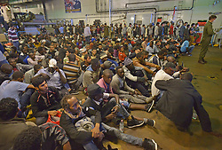 Migrants aboard HMS Bulwark having been rescued by Royal Marines from stranded boats, thirty miles off the Libyan coast.
