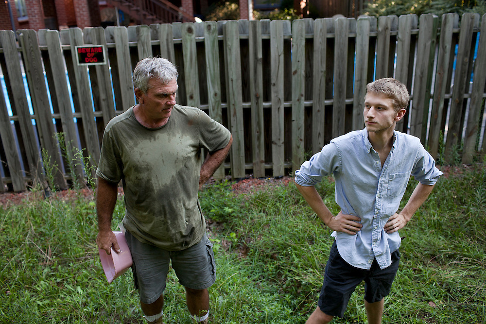 Matthew Richmond, right, created and owns the business Rent-A-Goat to contract with farmers like Jeff Mullins, left, to offer an eco-friendly brush clearing alternative, Chapel Hill, N.C., Thurs., July 22, 2010...D.L. Anderson for The Wall Street Journal..GOATS