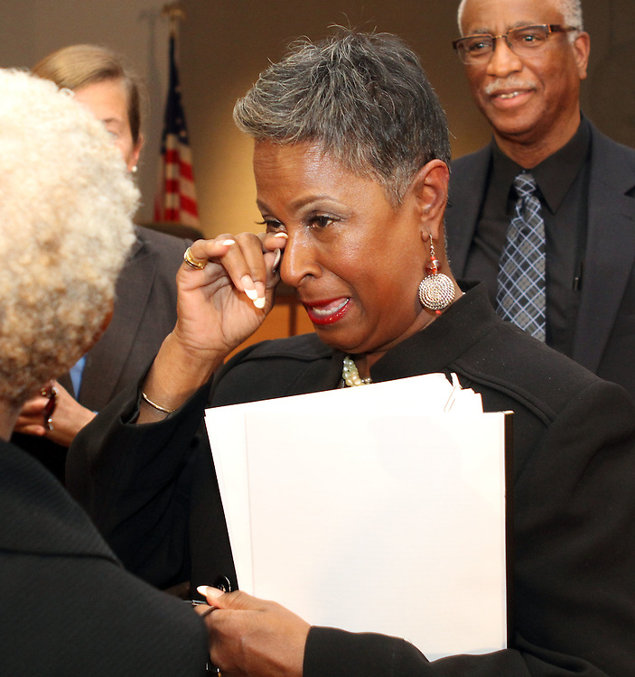Atlanta Public Schools board chair Brenda Muhammad wipes tears of joy after delivering the good news that the district's high schools are no longer on probation for board governance issues.