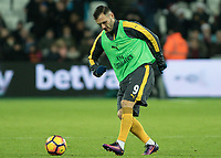 Football - 2016 / 2017 Premier League - West Ham United vs. Arsenal <br /> <br /> Lucas Perez of Arsenal warms up at half time at The London Stadium.<br /> <br /> COLORSPORT/DANIEL BEARHAM