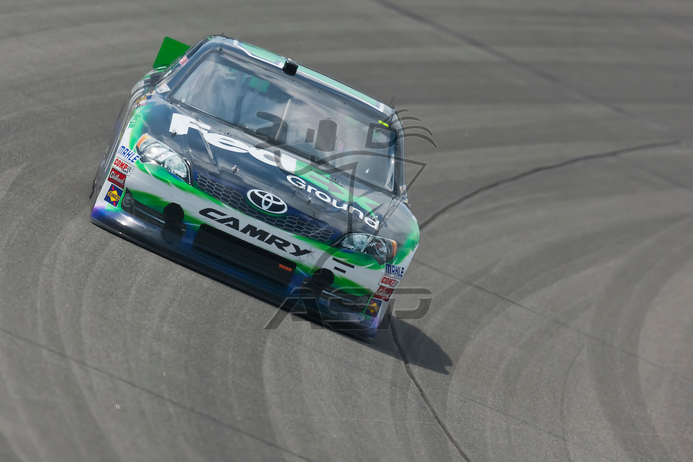 KANSAS CITY, KS - APR 20, 2012:  Denny Hamlin (11) brings his car through the turns during a practice session for the STP 400 at the Kansas Speedway in Kansas City, KS.