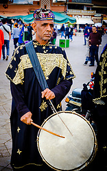 Percussionist in traditional costume entertaining tourists in the Jemaa El Fna, a world heritage site, Marrakech, Morocco<br /> <br /> (c) Andrew Wilson | Edinburgh Elite media