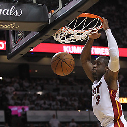 Jun 17, 2012; Miam, FL, USA; Miami Heat shooting guard Dwyane Wade (3) dunks against the Oklahoma City Thunder during the third quarter in game three in the 2012 NBA Finals at the American Airlines Arena. Mandatory Credit: Derick E. Hingle-US PRESSWIRE