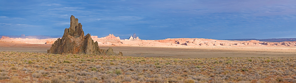 Panorama of storm light on Church Rock and Comb Ridge on the Navajo Indian Reservation near Kayenta, Arizona.