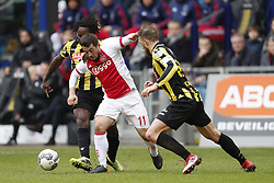 (L-R) Fankaty Dabo of Vitesse, Amin Younes of Ajax, Guram Kashia of Vitesse during the Dutch Eredivisie match between Vitesse Arnhem and Ajax Amsterdam at Gelredome on March 04, 2018 in Arnhem, The Netherlands