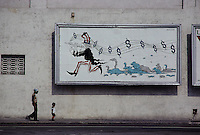ca. April 1980, Havana, Cuba --- Mural Depicting Uncle Sam as the Pied Piper of Hamelin --- Image by © Owen Franken/CORBIS