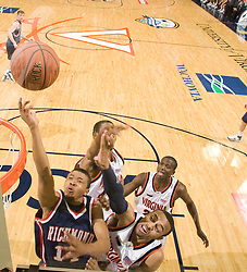 Richmond guard Kevin Anderson (14) shoots past Virginia guard Calvin Baker (4).  The Virginia Cavaliers men's basketball team defeated the Richmond Spiders 66-64 in the first round of the College Basketball Invitational (CBI) tournament held at the University of Virginia's John Paul Jones Arena in Charlottesville, VA on March 18, 2008.
