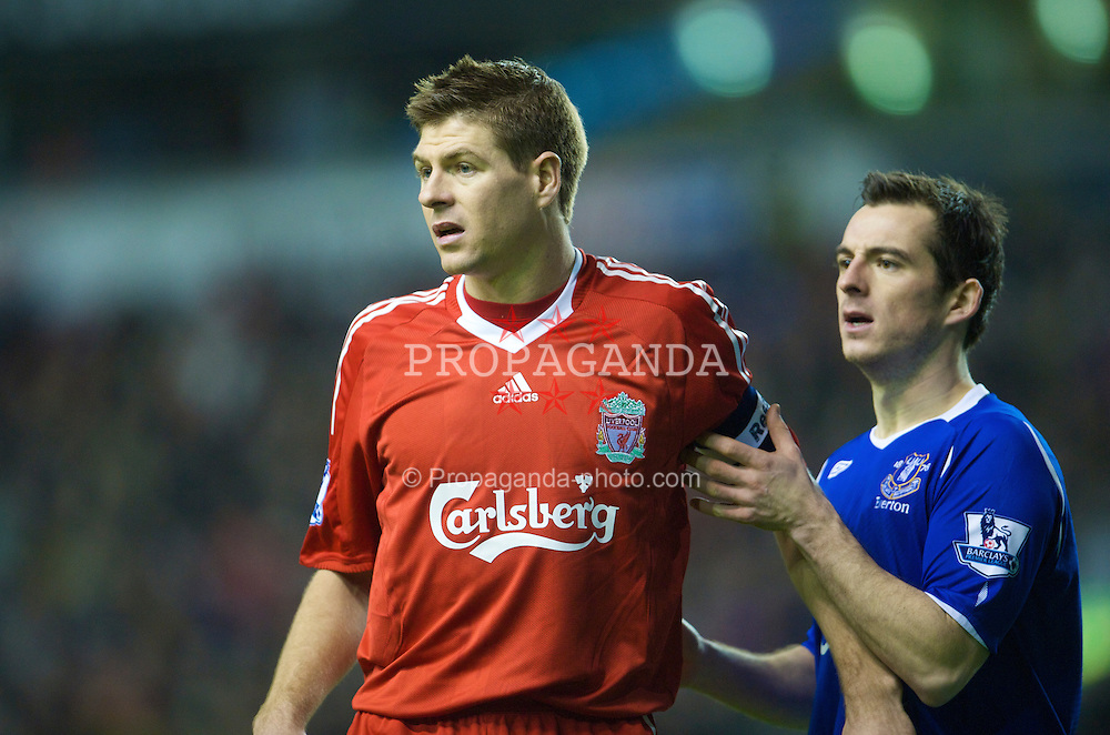 LIVERPOOL, ENGLAND - Sunday, January 25, 2009: Liverpool's captain Steven Gerrard MBE and Everton's Leighton Baines during the FA Cup 4th Round match at Anfield. (Photo by David Rawcliffe/Propaganda)