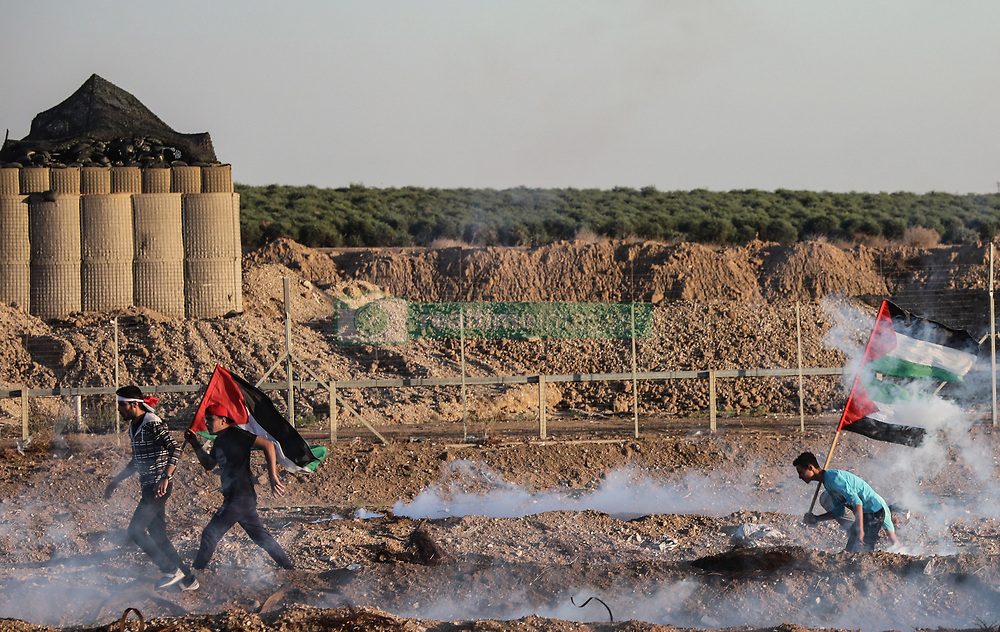 November 2, 2018 - Gaza Strip, Palestinian Territory, Gaza - Palestinian protesters are seen reacting to tear gas smoke canisters fired by the Israeli forces during clashes in east of Gaza City near the Israeli border. (Credit Image: © Nidal Alwaheidi/SOPA Images via ZUMA Wire)