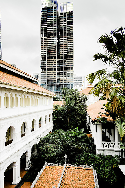 Raffles hotel with new construction in the background, Singapore