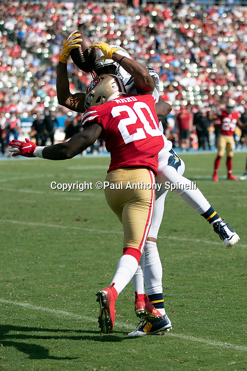 Los Angeles Chargers wide receiver Tyrell Williams (16) leaps and catches a third quarter pass for a gain of 24 yards and a first down at the San Francisco 49ers 25 yard line while covered by San Francisco 49ers defensive back Jimmie Ward (20) in the third quarter during the NFL week 4 regular season football game against the San Francisco 49ers on Sunday, Sept. 30, 2018 in Carson, Calif. The Chargers won the game 29-27. (©Paul Anthony Spinelli)