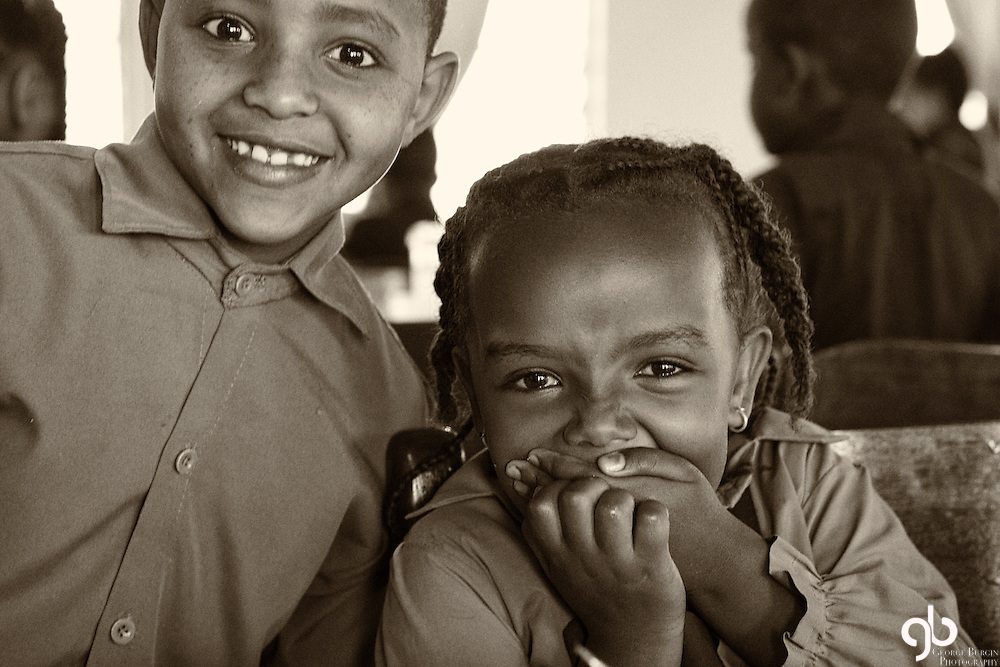 We were at the Rafiki compound near Mojo, Ethiopia.  During lunch I found these kids in the cafeteria.  My friend Rick was giving my rabbit ears behind me.