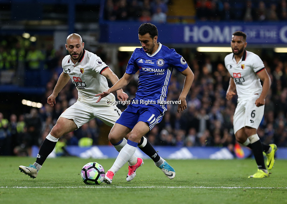 May 15th 2017, Stamford Bridge, London, England; EPL Premier League football, Chelsea FC versus Watford; Pedro of Chelsea in action with Nordin Amrabat of Watford marking
