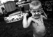 Harbour Point Estates resident John Russell,5 declares his supremacy after a short but spirited wrestling match with his little brother Kevin in their Chicago backyard.