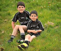 Young Tourmakeady supporters Matt and Adam Lydon keeping a eye on the action between Tourmakeady and Ballyhaunis during their Intermediate Championship clash.<br /> Pic Conor McKeown